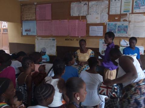 Pregnant women and lactating mothers listening an ANC session at a government hospital in Freetown